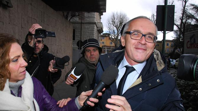 Former Monte dei Paschi di Siena General Manager Antonio Vigni, right, is chased by journalists upon his arrival at the courthouse building, in Siena, Italy, Wednesday, Feb. 6, 2013. Italian financial police are carrying out seizures of a total of €40 million ($54 million) as part of an investigation into embattled bank Monte dei Paschi di Siena. Prosecutors in Siena have been questioning former managers in recent days over allegations that the bank overpaid for the Italian bank Antonveneta, which it purchased for euro9.3 billion from Spanish bank Santander in 2007. The bank, informally known as Montepaschi, also is being investigated for three trades that are expected to cost it hundreds of millions of euros. Established in 1472, the bank is the world's oldest running financial institution. Its board met for six hours Wednesday but ended the session without releasing a statement. (AP Photo/Riccardo Sanesi, LaPresse)