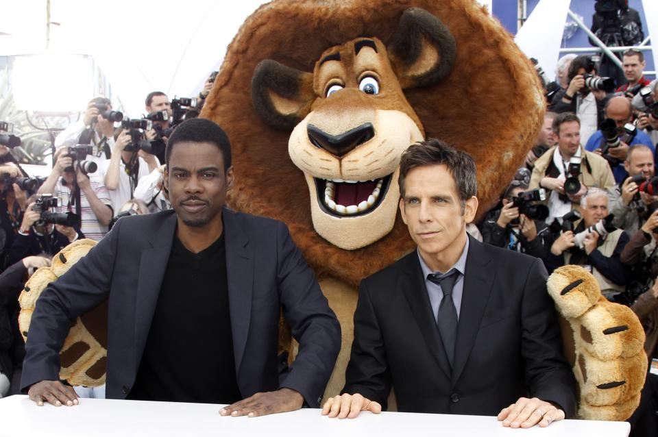 Actors Chris Rock, left, Ben Stiller, right and an actor dressed as a cartoon character, pose during a photo call for Madagascar 3: Europe's Most Wanted at the 65th international film festival, in Cannes, southern France, Friday, May 18, 2012. (AP Photo/Joel Ryan)