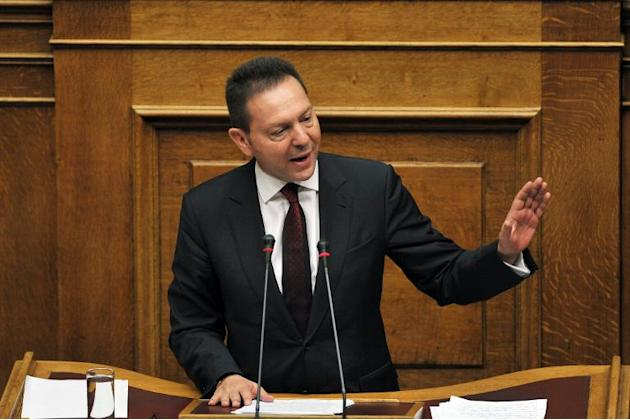 Greece's Finance Minister Yiannis Stournaras delivers a speech during the parliamentary session before the vote on the 2014 budget on December 7, 2013, in Athens