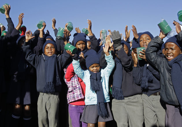 Children sing happy birthday in honour of former South African President Nelson Mandela during celebrations for Mandela&#39;s birthday in Mvezo, South Africa, Wednesday, July 18, 2012. Across the country, and even abroad, people are doing good deeds to honor the country&#39;s most famous statesman on his 94th birthday today. (AP Photo/Schalk van Zuydam)