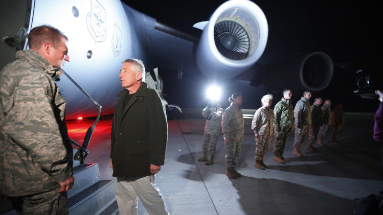Defense Secretary Chuck Hagel prepares to step aboard a C-17 military aircraft en route to Kabul, Afghanistan, after greeting U.S. troops stationed at Manas Air Force Base in Kyrgyzstan, Friday, March 8, 2013. Hagel arrived in Afghanistan Friday for his first visit as Pentagon chief, saying that there are plenty of challenges ahead as NATO hands over the country's security to the Afghans.  (AP Photo/Jason Reed, Pool)