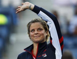 Kim Clijsters of Belgium waves to the gallery after her loss to Laura Robson of Britain in their women's singles match at the U.S. Open tennis tournament in New York August 29, 2012. The star-studded career of Clijsters ended in the place where it all began on Wednesday, just not quite in the way she would have wanted. The popular Belgian, who won as many friends for her bubbly, generous character as for her 'eyeballs-out' tennis and fighting spirit, saw her hopes of a fairytale goodbye dashed by British teenager Robson in the second round of the U.S. Open. REUTERS/Jessica Rinaldi