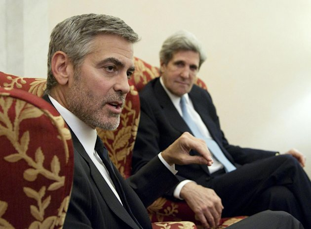 Actor George Clooney and Senate Foreign Relations Committee Chairman Sen. John Kerry, D-Mass. take part in an interview with The Associated Press, and other news organizations, Wednesday, March 14, 2012, on Capitol Hill in Washington. Clooney was to testify before the committee&#39;s hearing on Sudan. (AP Photo/Manuel Balce Ceneta)