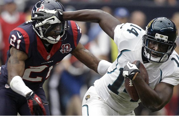 Jacksonville Jaguars wide receiver Justin Blackmon (14) breaks away from Houston Texans&amp;#39; Brice McCain (21) to score a touchdown during the fourth quarter of an NFL football game on Sunday, Nov. 18