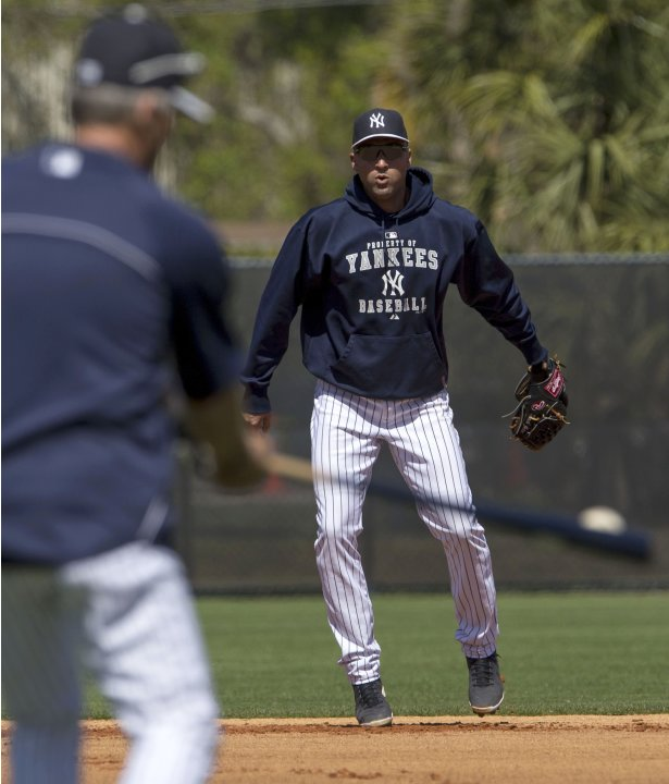 New York Yankees' Derek Jeter works out with the Yankees coaching staff during a spring training session in Tampa, Florida