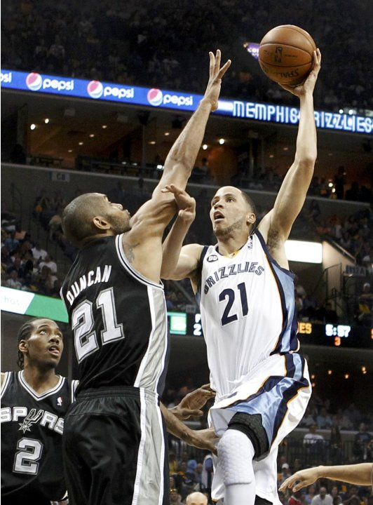 Grizzlies' Prince drives to the net on Spurs' Duncan during the third quarter in Game 3 of their NBA Western Conference final playoff basketball series in Memphis