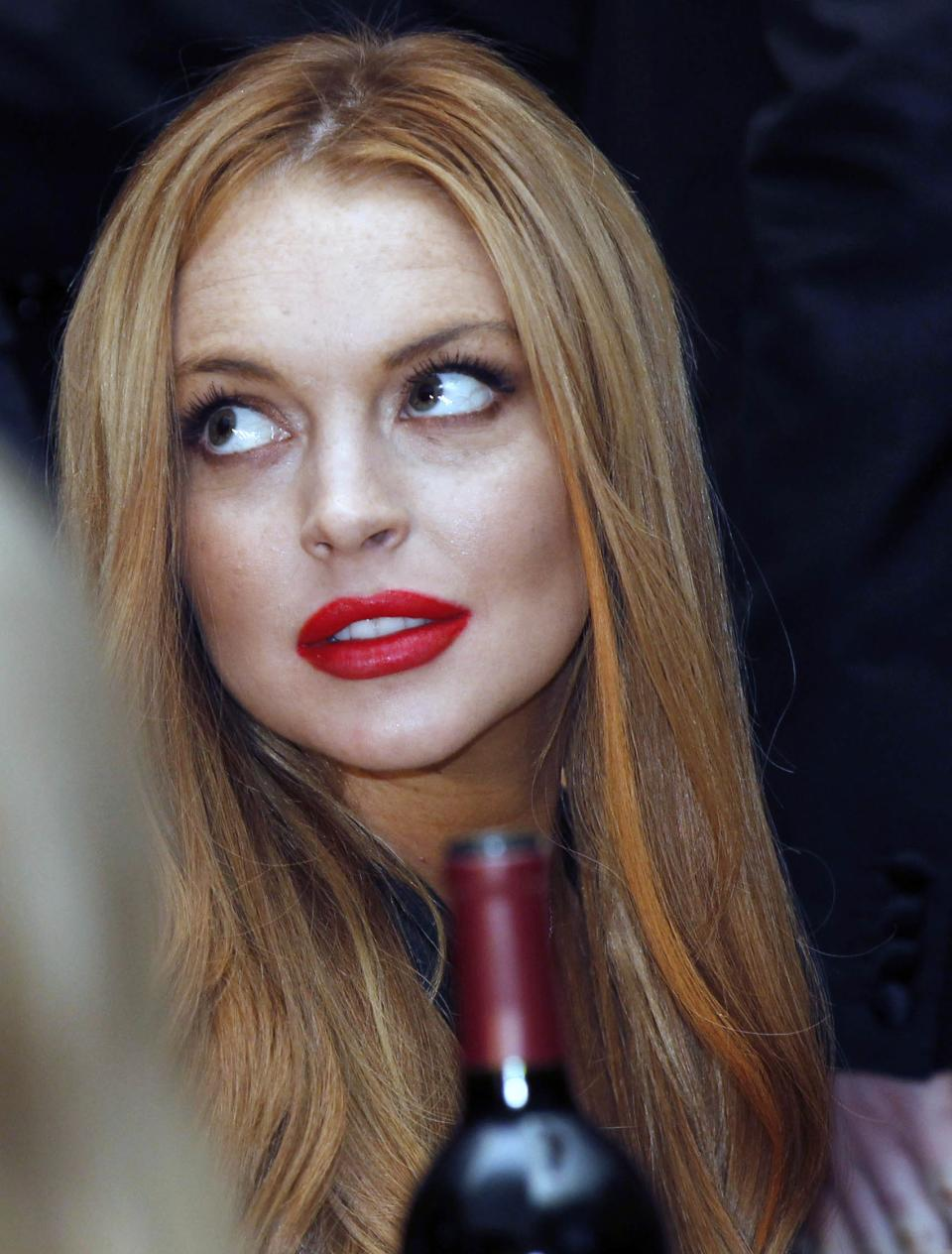 Lindsay Lohan attends the White House Correspondents' Association Dinner headlined by late-night comic Jimmy Kimmel, Saturday, April 28, 2012 in Washington. (AP Photo/Haraz N. Ghanbari)