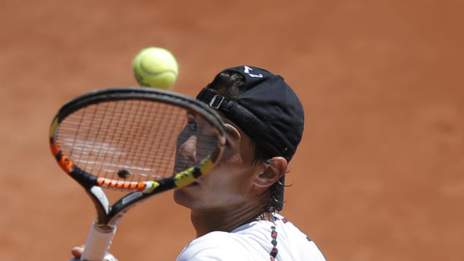 Defending champion Spain's Rafael Nadal returns the ball during a training session for the French Tennis Open at the Roland Garros stadium, Friday, May 22, 2015 in Paris. The French Open starts Sunday. (AP Photo/Francois Mori)