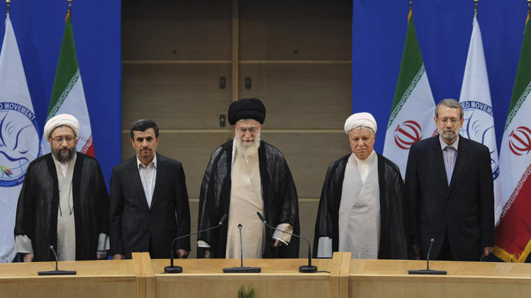 In this photo taken on Thursday, Aug. 30, 2012, and released by the official website of the Iranian supreme leader's office, supreme leader Ayatollah Ali Khamenei, center, parliament speaker Ali Larijani, right, chief of Expediency Council, Akbar Hashemi Rafsanjani, second right, President Mahmoud Ahmadinejad, second left, and judiciary chief Sadeq Larijani, left, listen to Iran's national anthem, at the opening session of the Nonaligned Movement, NAM, summit, in Tehran, Iran. (AP Photo/Office of the Supreme Leader)