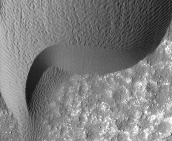This undated image provided by NASA shows a rippled dune, front, in Herschel Crater on Mars that moved an average of about two yards between March 3, 2007 and December 1, 2010. NASA's Mars Reconnaissance Orbiter (MRO) show sand dunes and ripples moving across the surface of Mars at dozens of locations and shifting up to several yards. These observations reveal the planet's sandy surface is more dynamic than previously thought. (AP Photo/NASA)