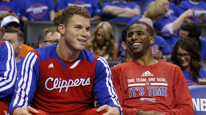 Los Angeles Clippers guard Chris Paul, right, laughs with teammate Blake Griffin, left, as they sit on the bench in the fourth quarter of Game 1 of the Western Conference semifinal NBA basketball playoff series in Oklahoma City, Monday, May 5, 2014. Los Angeles won 122-105