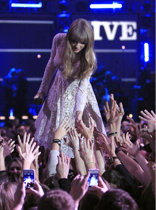 Host Taylor Swift at the Grammy Nominations Concert Live! at Bridgestone Arena on Wednesday, Dec. 5, 2012, in Nashville, Tenn. (Photo by Wade Payne/Invision/AP)