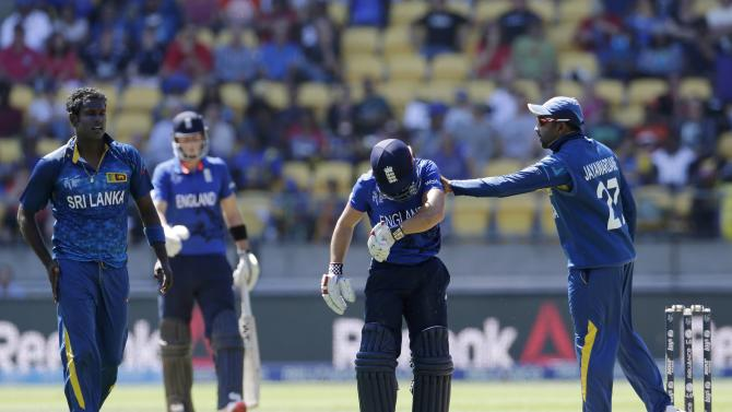 Sri Lanka's Jayawardene pats England's Taylor on the back after Taylor collided with Mathews during their Cricket World Cup match in Wellington