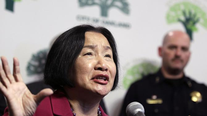 FILE - In this Oct. 13, 2011 file photo, Oakland Mayor Jean Quan gestures during a news conference at Oakland City Hall in Oakland, Calif. The city of Oakland took a big risk this year when it decided to borrow nearly $213 million to cover pensions owed to its retired police and firefighters. Rather than laying off more staff or reducing library services, leaders in this Northern California port city are betting that the stock market will improve. (AP Photo/Paul Sakuma, File)