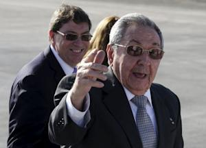 Cuba's president Castro talks to the media next to Cuba's Foreign Minister Rodriguez during the departure of French President Hollande at Jose Marti airport in Havana