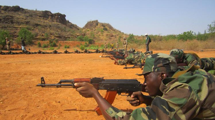 In this photo taken Monday, April 8, 2013, Malian soldiers practice shooting techniques, during a European Union training session in the village of Koulikoro, 60 kilometers (37 miles) outside Bamako, Mali. In preparation for the final pullout of French troops from Mali, a European Union team has started training Malian soldiers for battle against jihadists who overran much of this west African country before they were pushed back by a French military intervention. (AP Photo/Baba Ahmed)
