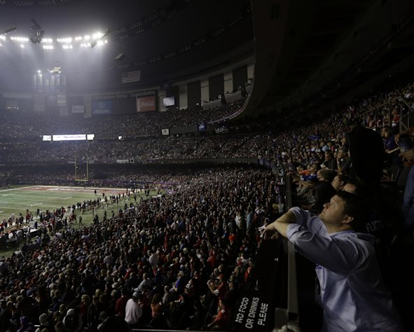 A fan looks around the Superdome after the lights went out during the second half of NFL Super Bowl XLVII football game Beyonce performs during the halftime show of Sunday, Feb. 3, 2013, in New Orleans. (AP Photo/Gerald Herbert)