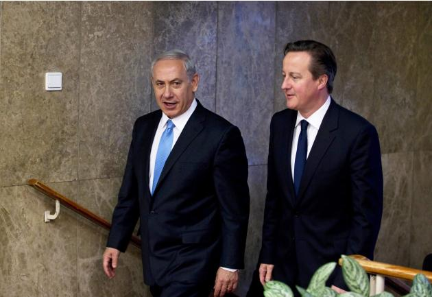 British PM Cameron walks with his Israeli counterpart Netanyahu before delivering joint statements in Jerusalem