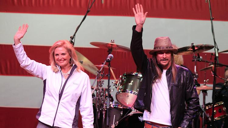 Ann Romney, wife of Republican presidential candidate, former Massachusetts Gov. Mitt Romney, and Kid Rock wave during the close of Mitt Romney's speech to supporters at the Royal Oak Music Theatre in Royal Oak, Mich., Monday, Feb. 27, 2012. (AP Photo/Carlos Osorio)