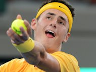 Bernard Tomic secured victory for Australia in their Davis Cup tie away to Uzbekistan