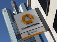 Commerzbank, Germany's second-biggest bank, said it expected net profit in the second half of the year to be lower than in the first half with no end to the eurozone debt crisis in sight