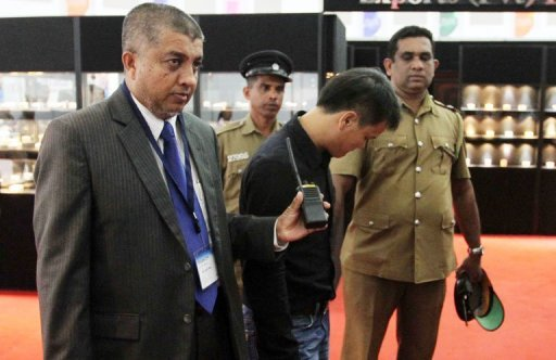 &lt;p&gt;A Sri Lankan security official and uniformed police escort a Chinese national (centre) who is accused of stealing a $13,800 diamond by swallowing it at the Facets Sri Lanka gem and jewellery exhibition in Colombo on Thursday.&lt;/p&gt;
