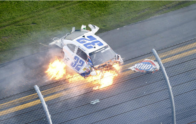NASCAR driver Kyle Larson's Chevrolet slides on fire down the front stretch on the final lap during the NASCAR Nationwide Series DRIVE4COPD 300 race at the Daytona International Speedway in Daytona Be