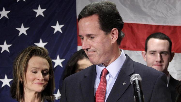 Former Pennsylvania Sen. Rick Santorum turns to his wife Karen, left, after announcing he is suspending his candidacy for the presidency, Tuesday, April 10, 2012, in Gettysburg, Pa.  (AP Photo/Gene J. Puskar)