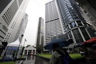 This file photo shows high-rises of the financial district in Singapore. Singapore has cleared the sale of Formula One shares for more than US$2.5 billion in one of the world's biggest flotations this year, reports said on Tuesday, with pre-marketing to begin immediately