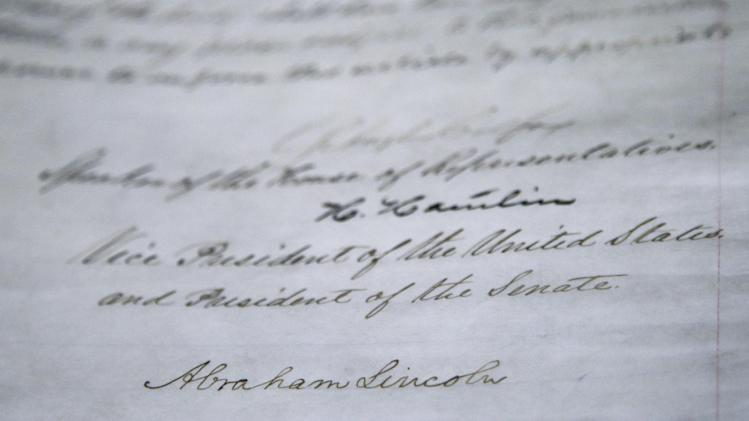 The signature of President Abraham Lincoln is seen on the 13th Amendment in a display at the Tennessee State Museum on Monday, Feb. 11, 2013, in Nashville, Tenn. The 13th Amendment, which abolished slavery, is on display along with the Emancipation Proclamation as part of an exhibit titled  Discovering the Civil War. (AP Photo/Mark Humphrey)