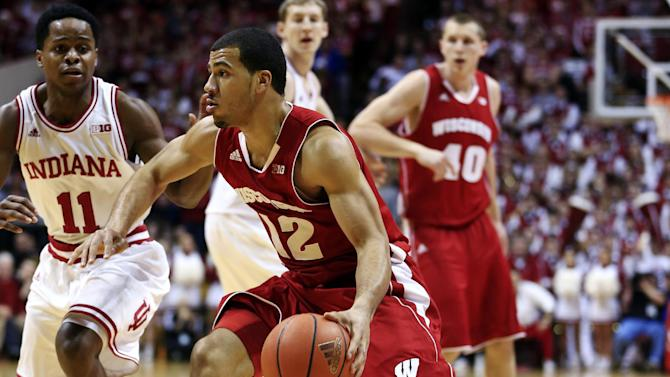 Wisconsin guard Traevon Jackson (12) drives on Indiana guard Yogi Ferrell (11) during the first half of an NCAA college basketball game, Tuesday, Jan. 15, 2013, in Bloomington, Ind. (AP Photo/Darron Cummings)