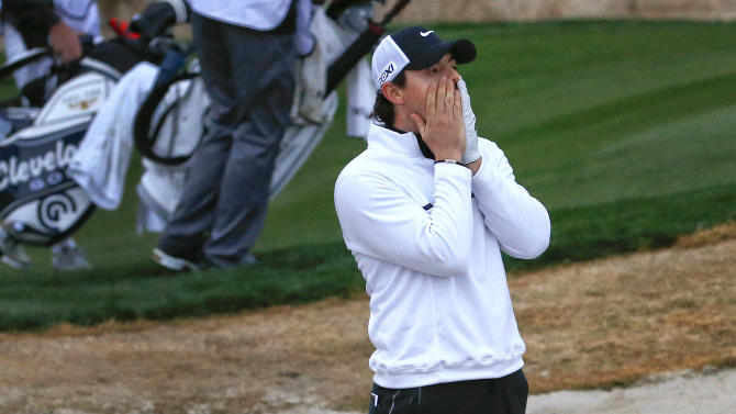 Northern Ireland's Rory McIlroy reacts after hitting out of the bunker onto the 18th green and just missing the pin in the first round against Shane Lowry, of Ireland, during the Match Play Championship golf tournament, Thursday, Feb. 21, 2013, in Marana, Ariz. Lowry won 1 up. (AP Photo/Ross D. Franklin)