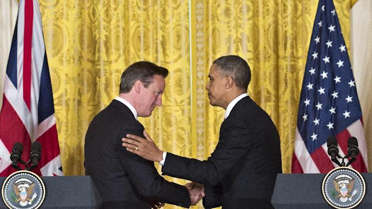 President Barack Obama shakes hands with British Prime Minister David Cameron at the end of a joint news conference, Monday, May 13, 2013, in the White House East Room in Washington where they discussed various topics including Syria's civil war to preparations for a coming summit in Northern Ireland. (AP Photo/J. Scott Applewhite)