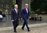 US Secretary of State John Kerry (R) and Defense Secretary Chuck Hagel leave the Chidori ga Fuchi National Cemetery in Tokyo on October 3, 2013
