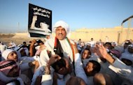 Kuwaiti former opposition MP Mussallam al-Barrak is cheered by supporters after he was freed from the central prison in Kuwait City. His release follows a night of violent protests against his detention that left dozens hurt