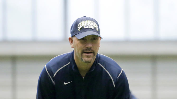 FILE - In this Jan. 10, 2013 file photo, Seattle Seahawks defensive coordinator Gus Bradley watches team NFL football practice in Renton, Wash. The Jacksonville Jaguars have hired Seattle defensive coordinator Gus Bradley as head coach. ESPN first reported the hire Thursday, Jan. 17, 2013. (AP Photo/Ted S. Warren)