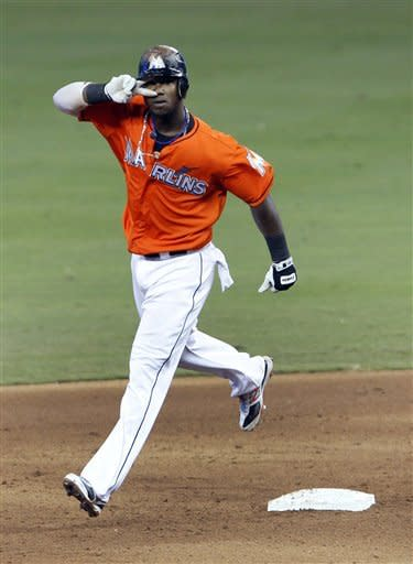 Marlins beat Astros in 11 innings, 5-4