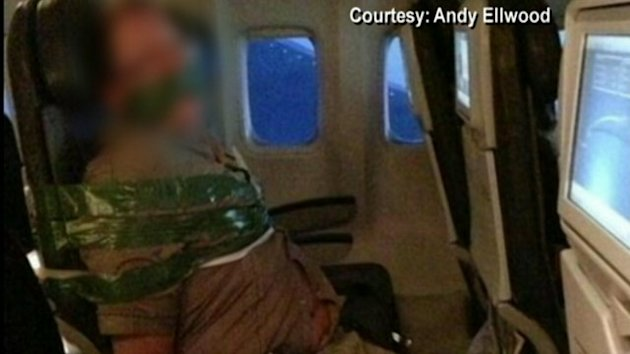 Raging Airplane Passenger Duct Taped to Seat (ABC News)