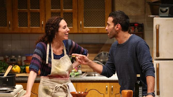 """This theater publicity photo provided by Richard Kornberg & Associates shows Lameece Issaq, left, and Haaz Sleiman in a scene from """"Food and Fadwa,"""" in New York.  (AP Photo/Richard Kornberg & Associates, Joan Marcus)"""