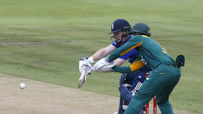 England's Eoin Morgan plays a shot with South Africa's Quinton de Kock looking on during the One Day International Cricket match in Cape Town