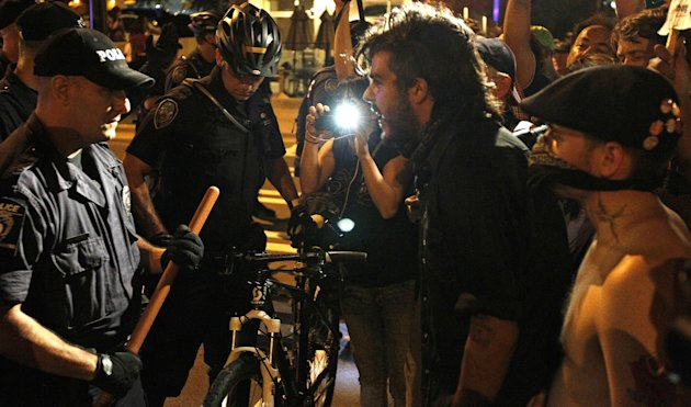 Occupy Demonstrators march at night, Wednesday, Sept. 5, 2012, in Charlotte, N.C., during the second day of the Democratic National Convention. (AP Photo/Gerry Broome)