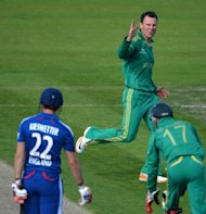 South Africa&#39;s Johan Botha (C) celebrates after taking the wicket of England&#39;s Craig Kieswetter (L) during their first T20 match on September 8. Botha and Robin Peterson took four wickets between them, as South Africa provided the latest evidence they are no longer solely reliant on pace bowling