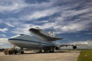 Space shuttle Endeavour stands atop the Shuttle Carrier Aircraft ahead of its flight to Los Angeles in September 2012. Endeavour is destined to be displayed for public viewing at the California Science Center.