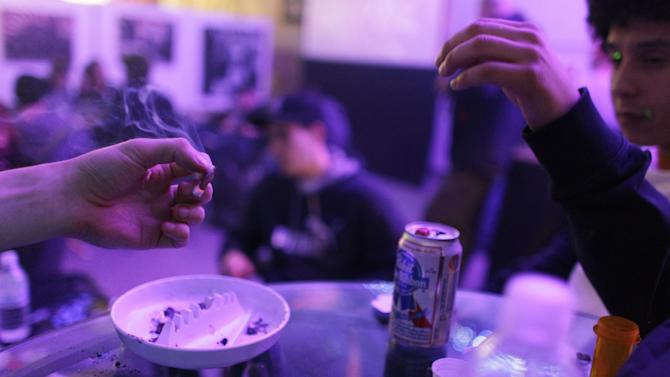 A joint is passed around on the official opening night of Club 64, a marijuana-specific social club, where a New Year's Eve party was held, in Denver, Monday Dec. 31, 2012. On Election Day, Nov. 6, 2012, a plurality of Coloradans voted in favor of Proposition 64 to legalize recreational marijuana. (AP Photo/Brennan Linsley)