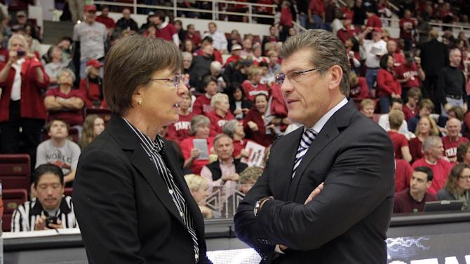 CORRECST SPELLING OF COACHES NAMES - Connecticut head coach Geno Auriemma, right, talks with Stanford head coach Tara VanDerveer before the start of their NCAA college basketball game in Stanford, Calif., Saturday, Dec. 29, 2012. (AP Photo/Tony Avelar)