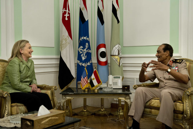 US Secretary of State Hillary Rodham Clinton listens to Field Marshal Hussein Tantawi before a meeting at the Ministry of Defense July 15, 2012 in Cairo, Egypt. Clinton is holding talks with Egypt's top military leaders to press for the military to work with Egypt's new Islamist leaders on a full transition to civilian rule. (AP Photo/Brendan Smialowski, Pool)