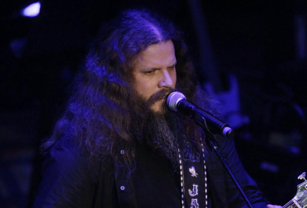 "FILE - In this Sept. 19, 2011 file photo, Jamey Johnson performs during the Academy of Country Music Honors show in Nashville, Tenn. Johnson pays tribute to Hank Cochran with the release this week of ""Living for a Song: A Tribute to Hank Cochran,"" a deep look at the songwriter's career. Johnson teams up with stars like Willie Nelson, George Strait and Alison Krauss on what is mostly a duets album comprised of such Cochran classics as ""Make The World Go Away"" and ""I Fall To Pieces."" Co-produced by Cochran's friends Buddy Cannon and Dale Dodson, the 16-track album also includes one Johnson solo song, ""Would These Arms Be In Your Way.""(AP Photo/Mark Humphrey)"