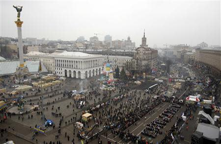 "Pro-European integration protesters form the Ukranian word ""Lustration"" at Independence Square in Kiev"
