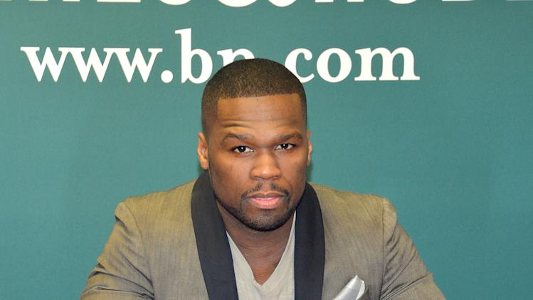 "50 Cent Signs Copies Of His Book ""Formula 50: A 6-Week Workout and Nutrition Plan That Will Transform Your Life"""