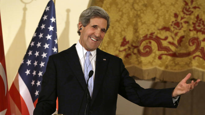 FILE - In this March 1, 2013, photo, U.S. Secretary of State John Kerry speaks at a news conference with Turkish Foreign Minister Ahmet Davutoglu at Ankara Palace in Ankara, Turkey. With the smile of a seasoned politician, a flair for languages and a vast repertoire of personal anecdotes, Kerry schmoozed and cajoled his way through Europe and the Middle East on his first trip abroad as America's top envoy over the past 10 days. (AP Photo/Jacquelyn Martin, Pool, file)